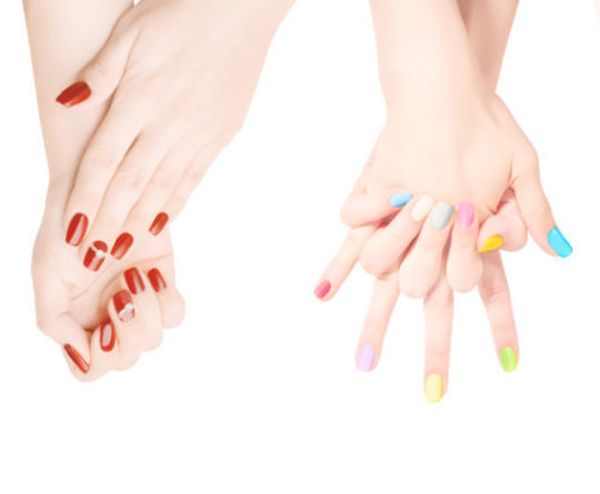 Woman hands with colored nail polish set in the row. Isolated on white